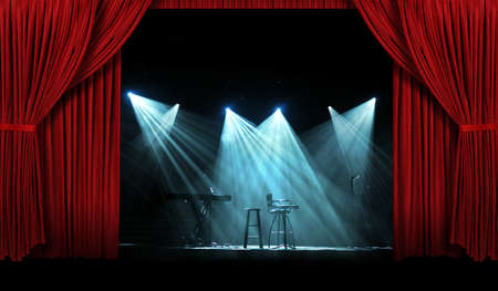Concert stage with large red curtains with lights photo