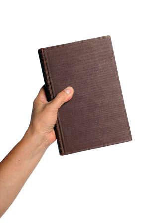libros antiguos: Mano sostiene libro vintage aislado sobre fondo blanco