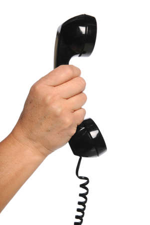 receiver: Hand holding vintage telephone receiver isolated over white background