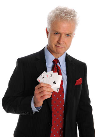 Portrait of mature businessman holding playing cards with aces isolated over white background Stock Photo - 8415109