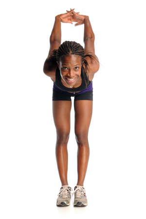 mujer deportista: Mujer afroamericana estiramiento aislados sobre fondo blanco Foto de archivo