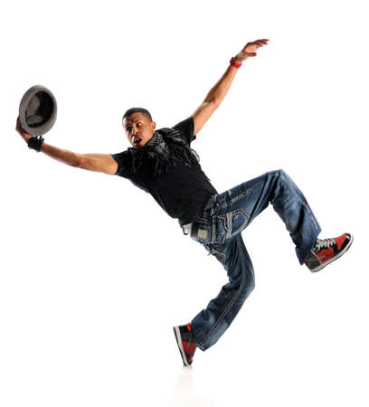 African American hip hop dancer performing with hat isolated over white background