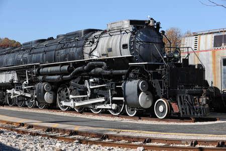 Vintage weathered locomotive with large engine photo