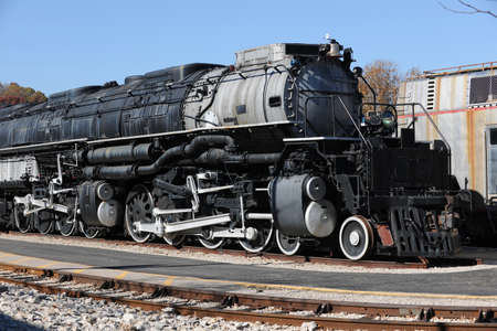 Vintage weathered locomotive with large engine photo