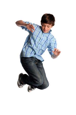 Ritratto di giovane ragazzo saltando isolato su sfondo bianco Archivio Fotografico - 8415373