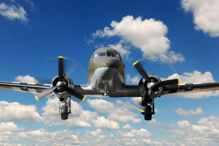Vintage C-47 airplane landing during sunny bright day photo