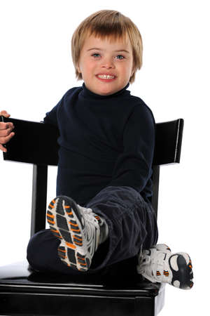 down sitting: Portrait of child with Down Syndrome smiling isolated over white background
