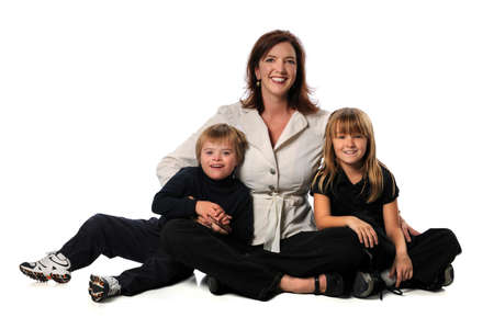 down sitting: Mother, daughter and son with Down Syndrome sitting isolated over white background