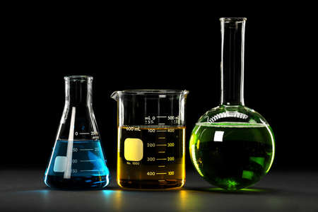 Laboratory glasswware with liquids of different colors Stock Photo
