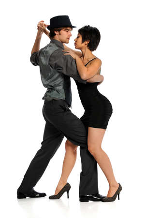 Couple dancing tango isolated over white background photo