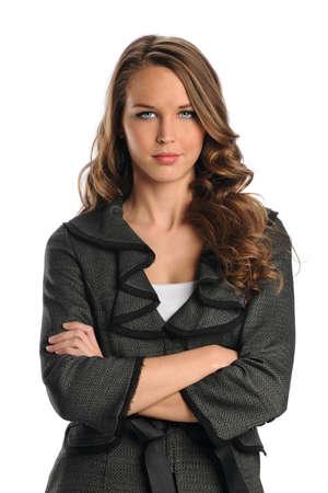 Portret van jonge zakenvrouw met armen overgestoken geïsoleerde witte achtergrond Stockfoto