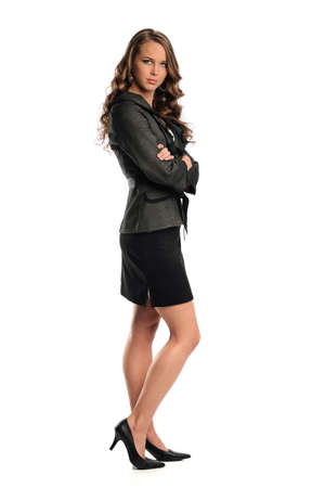 Portrait of businesswoman standing isolated over white background Stock Photo - 10870828