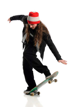 Young skateboarder in action isolated over white background photo