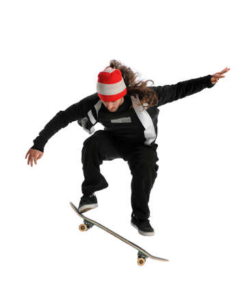 skateboarding tricks: Young skateboarderjumping performing a trick isolated over white background