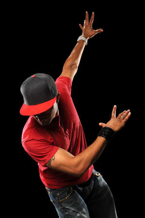rapping: African American hip hop dancer performing isolated over black background Stock Photo