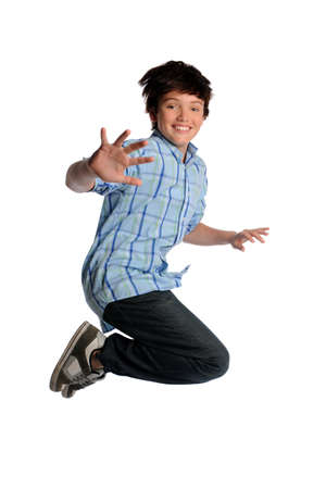Young boy jumping isolated over white background