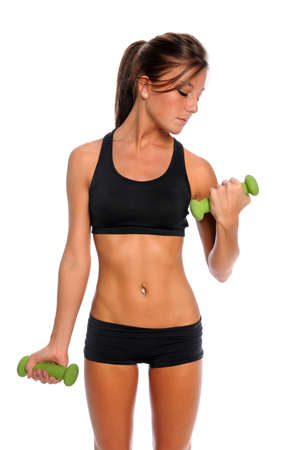 Beautiful young woman curling dumbbell isolated over white background 版權商用圖片