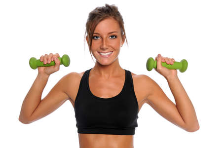Beautiful young woman lifting dumbbells isolated over white background photo