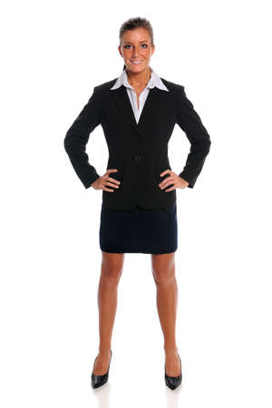 Beautiful businesswoman standing with hands on hips isolated over white background Stock Photo - 10870802