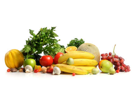 fresh produce: Assortment of fresh fruits and vegetables isolated over white background