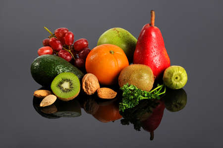 with reflection: Fresh fruits and vegetables with reflections on table