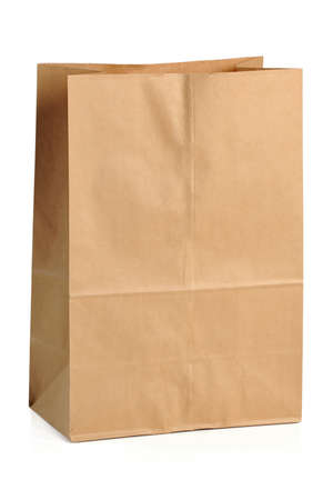 Brown paper bag isolated over white background Imagens