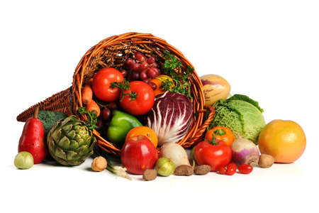 Cornucopia with fresh fruits and vegetables isolated over white background
