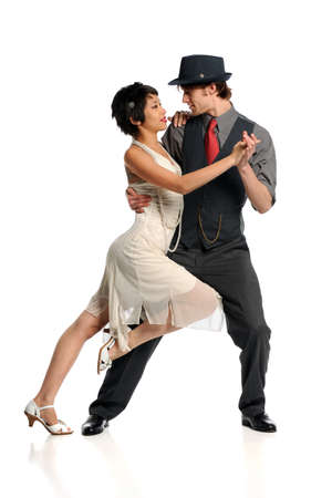 Couple dancing Tango isolated over white background