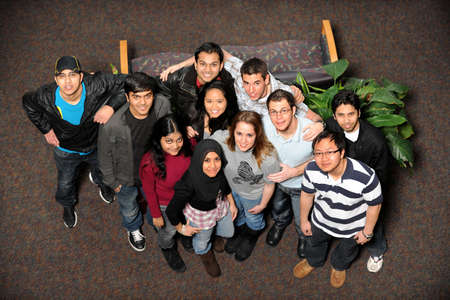 Young men and women of diverse ethnic groups standing together photo