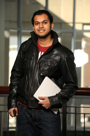 Portrait of Indian student smiling in a university setting photo