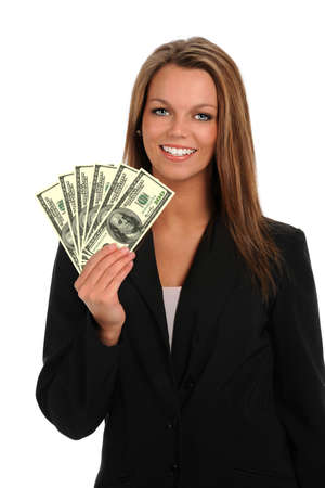 Portrait of young businesswoman holding hundred dollar bills isolated over white background
