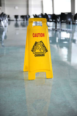 janitorial: Wet floor caution sign on floor Stock Photo
