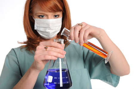 Female laboratory tech mixing chemicals isolated over white background Stock Photo - 15122742