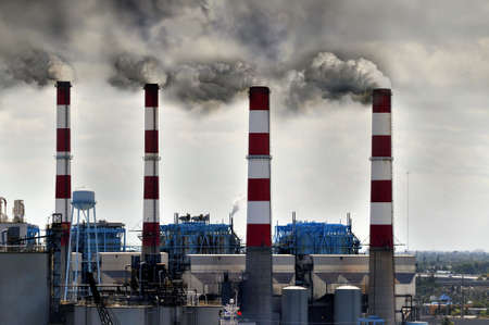 polluting: Industrial smokestacks blowing smoke into the enrironment