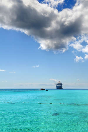 Passenger cruise ship anchored in tropical waters photo