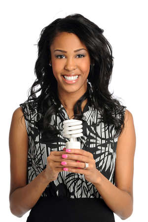 African American businesswoman holding fluorescent bulb isolated over white background photo