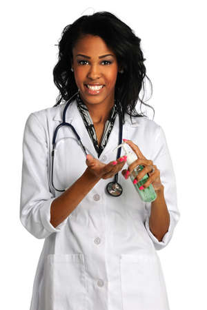 sanitizer: Beautiful African American doctor using hand sanitizer isolated over white background