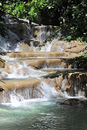 Dunns River Falls in Ocho Rios Jamaica during sunny day photo