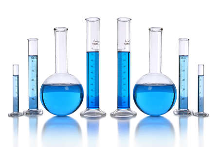 Laboratory glassware with blue liquid isolated over white background