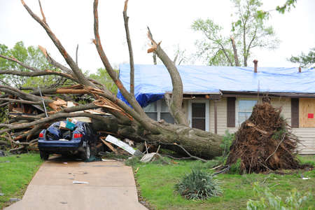 fema: SAINT LOUIS, MISSOURI - APRIL 23: Damaged home with tarp-covered roof after tornados hit the Maryland Heights area on Friday April 22, 2011