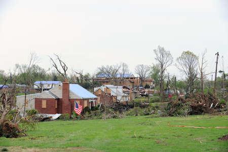 fema: SAINT LOUIS, MISSOURI - APRIL 23: Damaged homes show tarp-covered roofs after tornados hit the Bridgeton area on Friday April 22, 2011