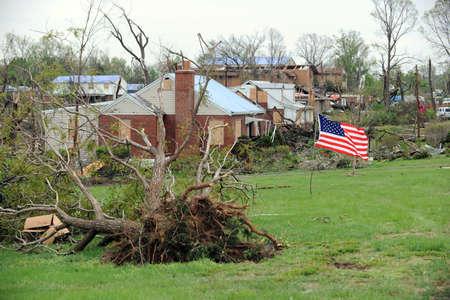 fema: SAINT LOUIS, MISSOURI - APRIL 24: A US flag flies amidst damaged homes  after tornados hit the Bridgeton area on Friday April 22, 2011