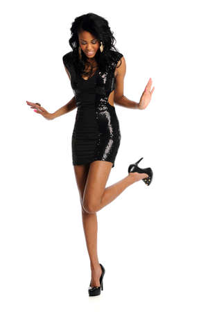 Beautiful young African American woman in black dress isolated over white background 스톡 콘텐츠