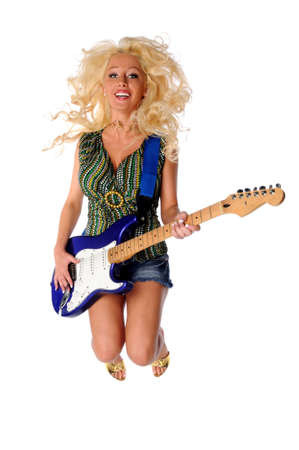 sexy guitar: Beautiful young woman playing guitar and jumping isolated over white background