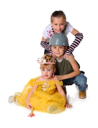 Young children dressed in costumes isolated over white background