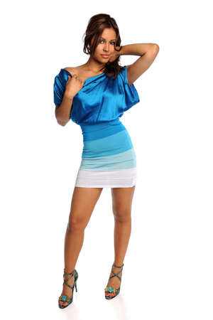 outfit: Portrait of beautiful Hispanic woman in blue dress and heels isolated over white background
