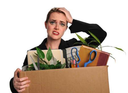 belongings: Upset businesswoman carrying office belongings after loosing job