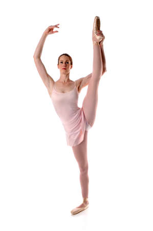 Ballerina stretching isolated over white background 免版税图像