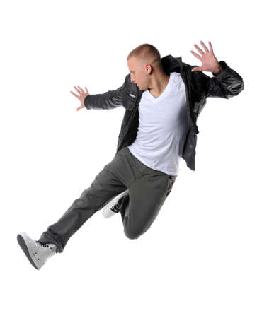 Young hip hop dancer jumping isolated over white background photo