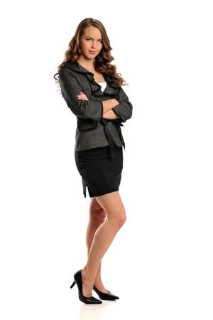 Portrait of beautiful young businesswoman with arms crossed isolated over white background